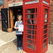 Susan Chamberlain and Vette Visions  waiting for a call at a typical England phone booth.jpg